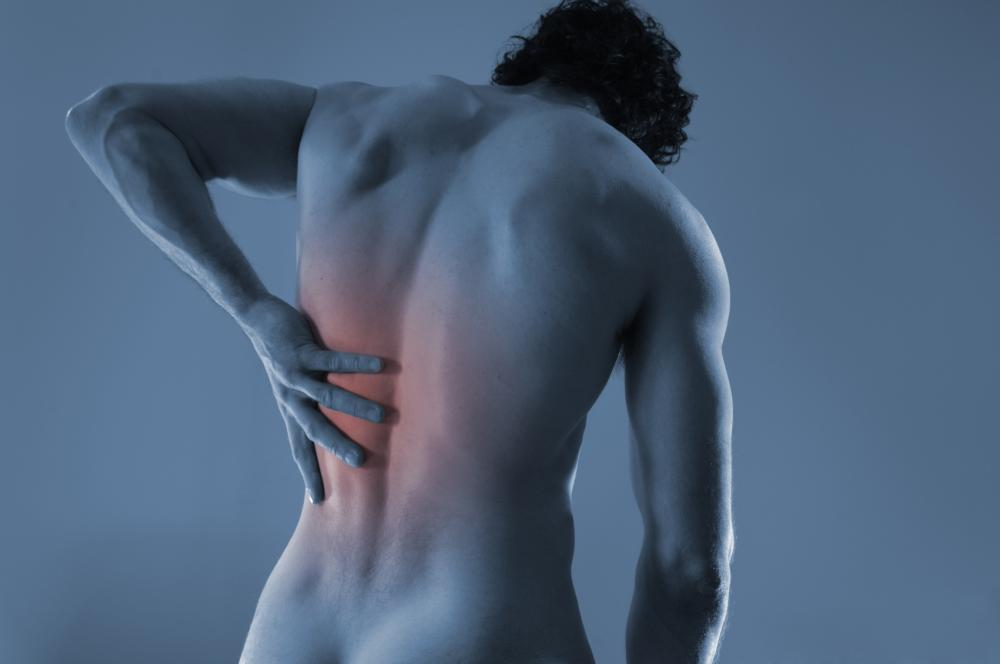 man with hand on his back from back pain.