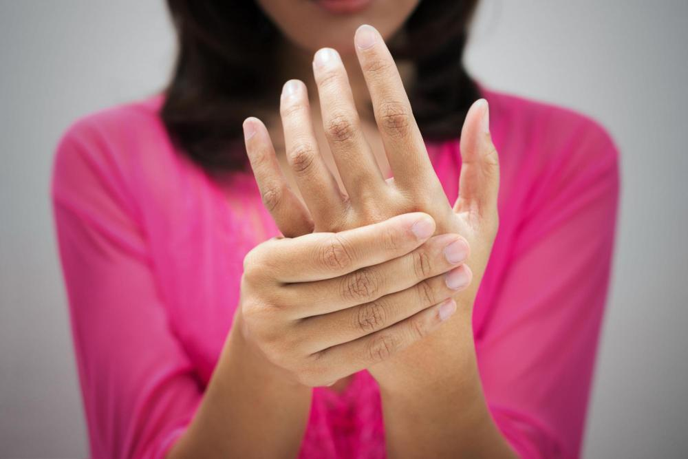 Woman experiencing fibromyalgia pain in her hand