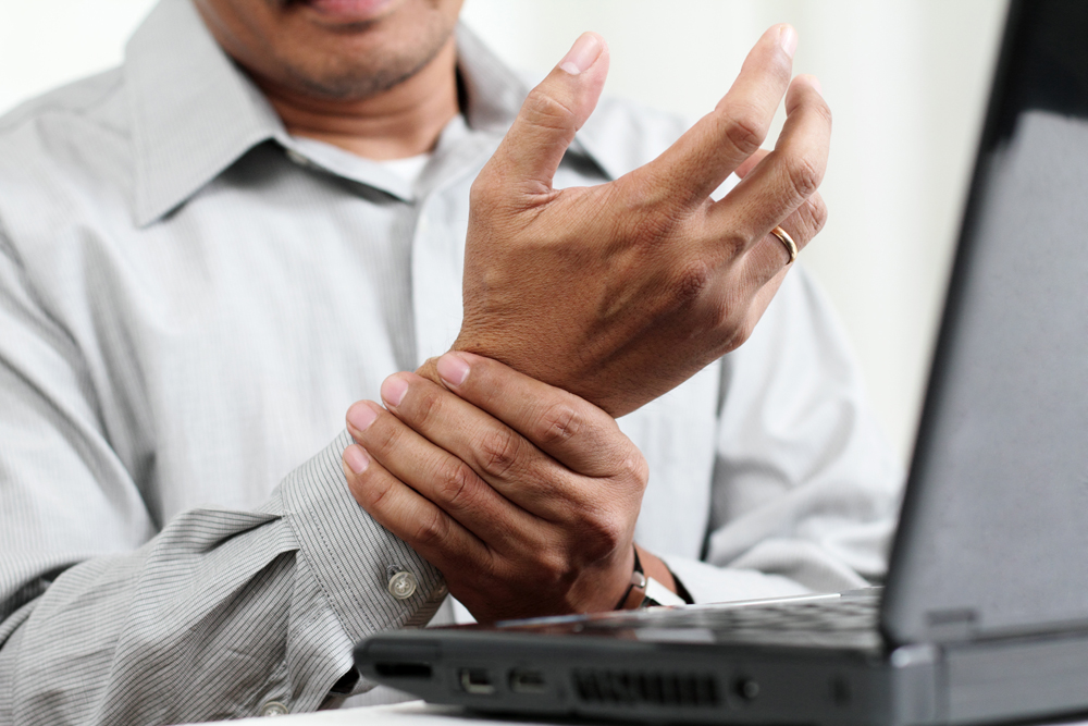 Man with Carpal Tunnel Syndrome needs chiropractic care.