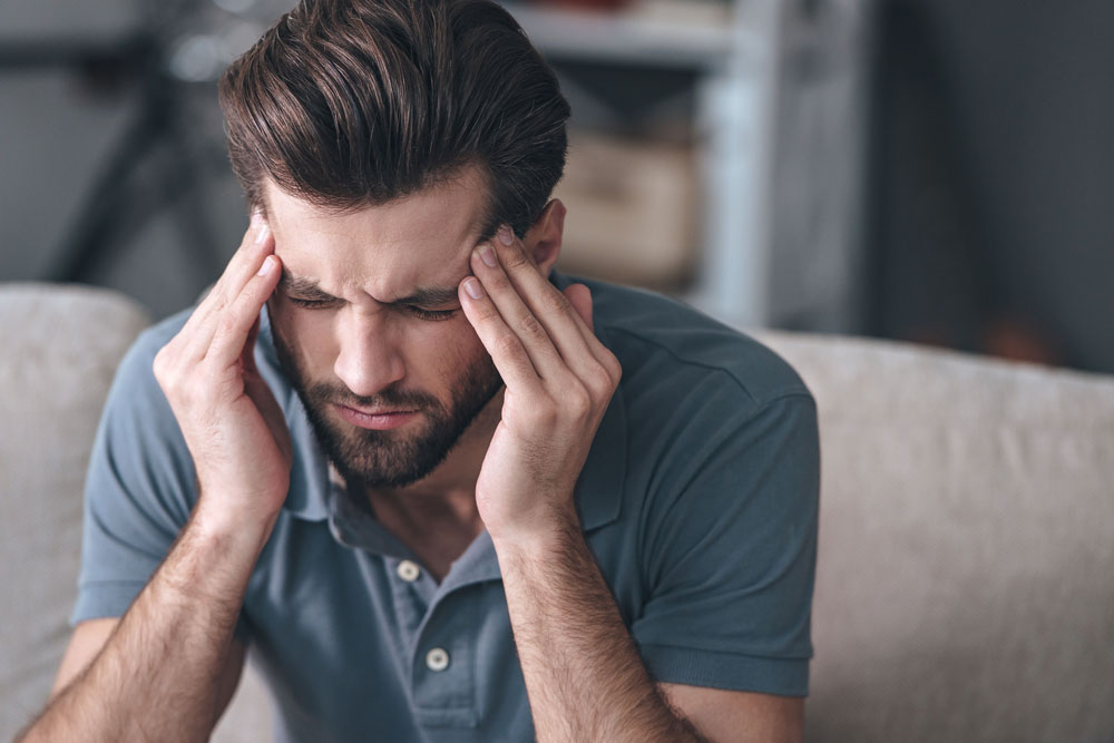 Man with chronic headaches needs chiropractic care in Livonia, MI.