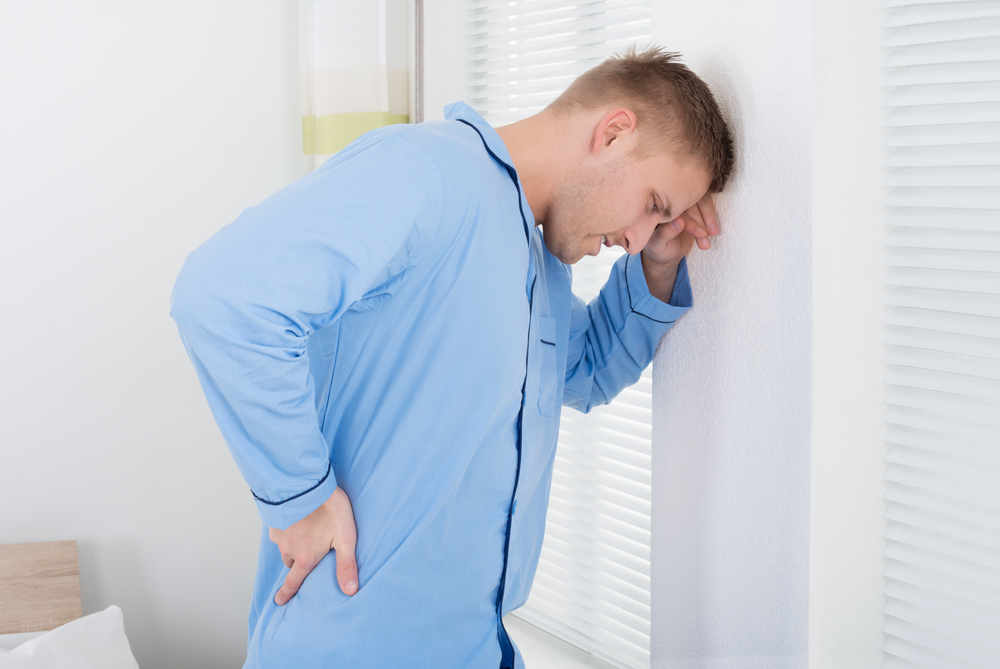 man with back pain in Livonia