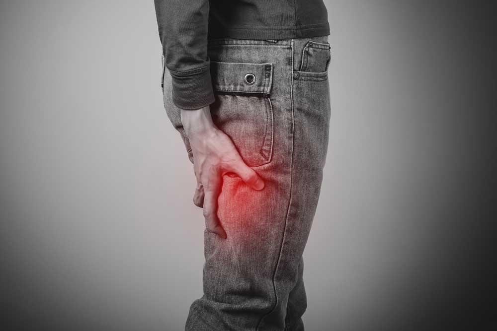 man with sciatica, lower back and leg pain.